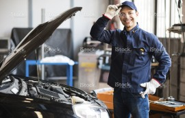 stock-photo-64373539-smiling-mechanic